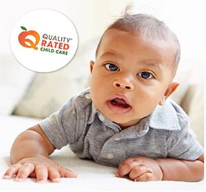 Photo of a baby with the Quality Rated Child Care logo on it