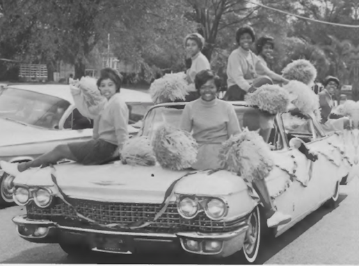 Historical Photo of young women on a car in a parade