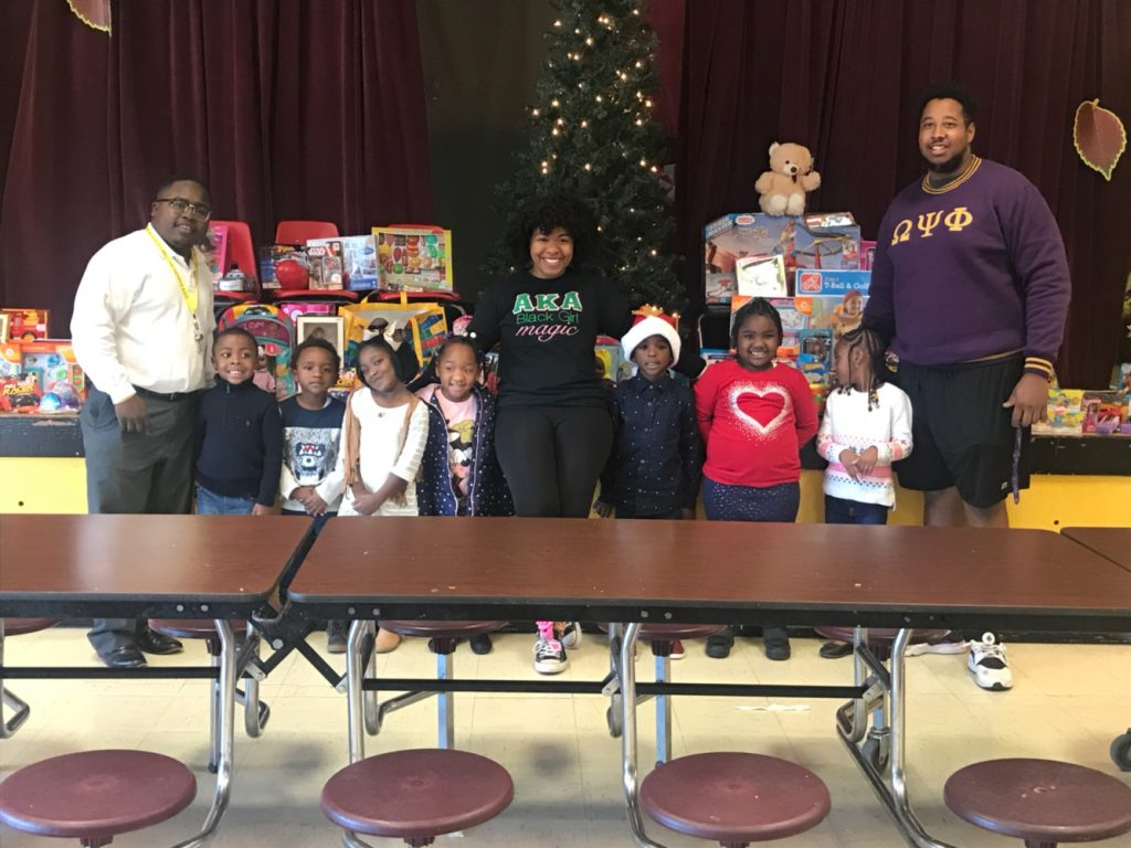 Ten ASU Greek Life organizations collected 200 toys for children attending Sylvandale Academy. Bernard Goins, Greek Life Coordinator (left), Erin Baugh, member of Alpha Kappa Alpha Sorority (center), and Douglas Turner, member of Omega Psi Phi Fraternity (right), delivered the items to the elementary school. The toy drive was hosted by the Greek President's Council. This is the first year of the toy drive.